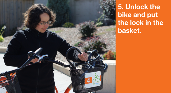 5. Unlock the bike and put the lock in the basket.